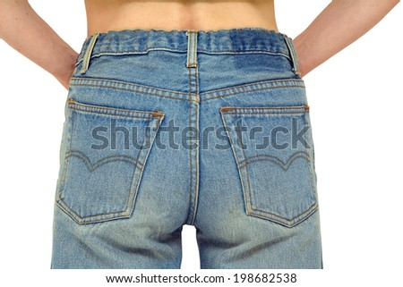 Rear body part with faded blue jeans on, arms in pockets. Isolated on white, clipping path included.
