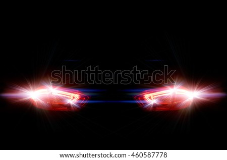 Rear car lights on a black background