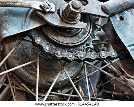 Rear gear of old bike in high dynamic range photograph - stock photo