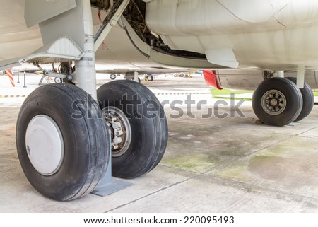 rear landing gear and engine passenger plane on the ground