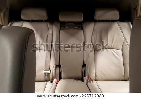 Rear leather seats. Car interior. - stock photo
