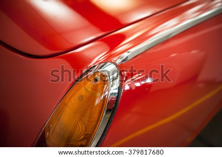 Rear light of a vintage car in a salon - stock photo
