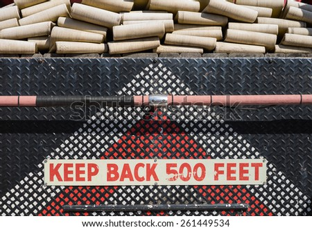 Rear of an antique firetruck with fire hoses, keep back sign, and back of truck. - stock photo