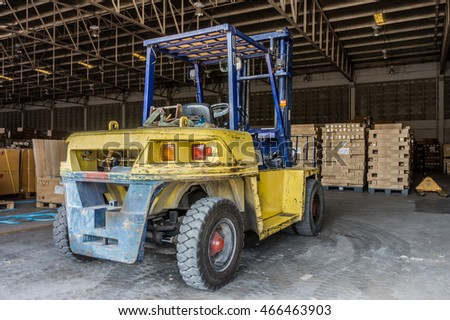 Rear of old forklift vehicle used in industrial warehouse. It is also called lift or fork truck.