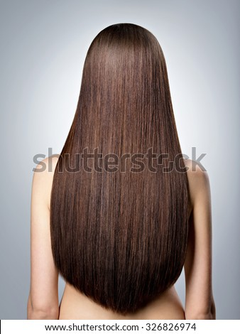 Rear Portrait of  woman with long brown straight  hair at studio - stock photo