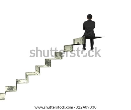 Rear view businessman sitting on top of money stairs, with white background. - stock photo
