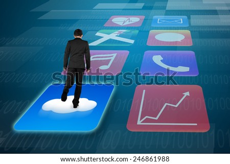 Rear view businessman surfing on shiny cloud app icons with tech background - stock photo