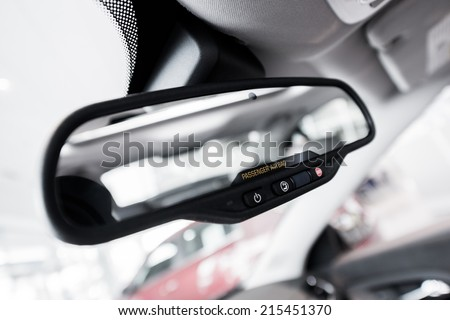 Rear View Interior Car Mirror with Safety Buttons and Passenger Airbag Indicator Closeup.