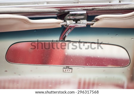 Rear view mirror closeup in vintage car - stock photo