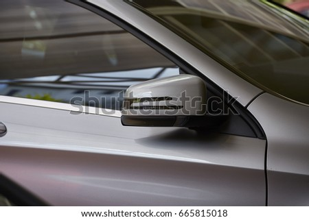 Rear view mirror of new gray car