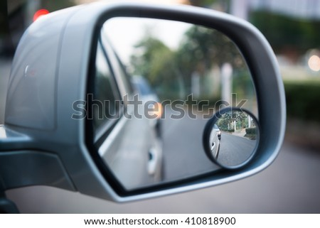 Rear view mirror outside car for safety - stock photo