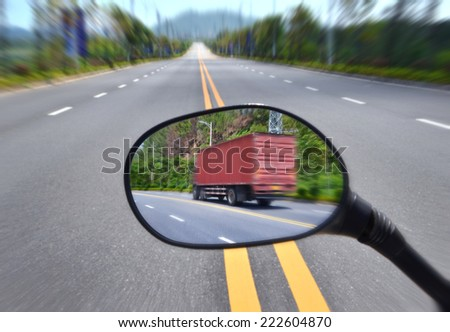 Rear View Mirror Reflecting Road,Truck driving  - stock photo