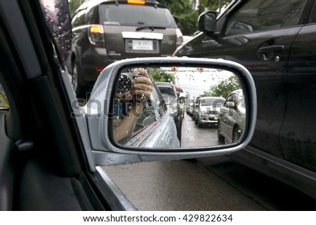 rear view mirror traffic jam in rainy morning