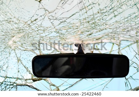 Rear-view mirror with shattered windshield.