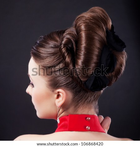 Rear view of a beautiful coiffure. Pigtails. Braid. Backside studio shot. - stock photo