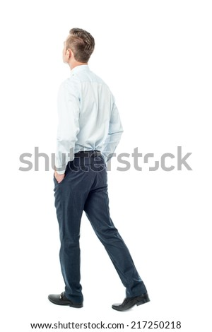 Rear view of a business executive walking forward - stock photo