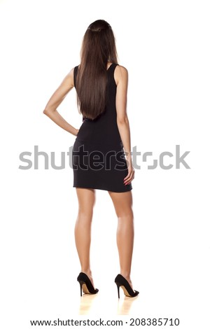 rear view of a business woman in a short black dress - stock photo