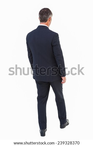 Rear view of a businessman posing on white background