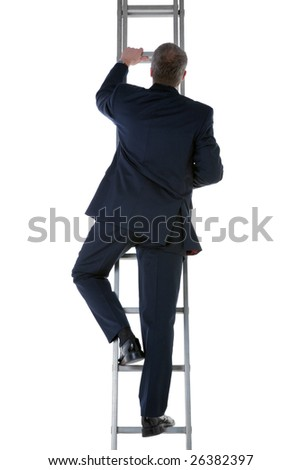 Rear view of a businessman wearing a blue suit climbing a ladder - stock photo