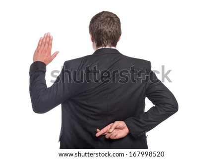 Rear view of a businessman with crossed fingers and stop gesture over white background - stock photo