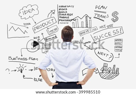 rear view of a caucasian businessman looking at the writings on white board. - stock photo