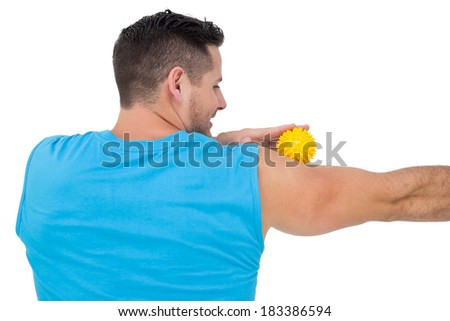 Rear view of a content young man holding stress ball over white background - stock photo