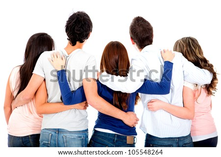 Rear view of a group of friends hugging - isolated over a white background - stock photo