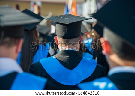 Rear view of a group of graduate students on a ceremony