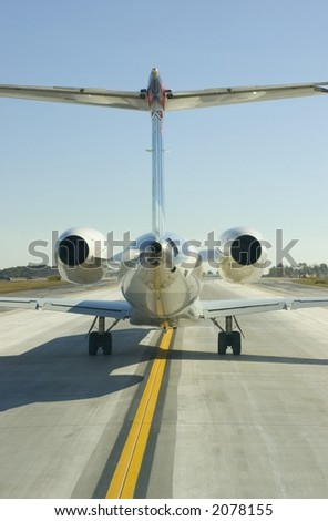 Rear view of a jet tail - stock photo