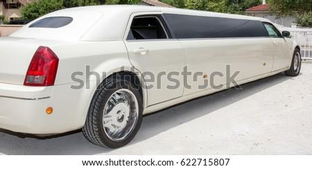 rear view of a long white limousine car