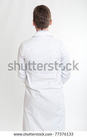 Rear view of a man on lab coat - stock photo