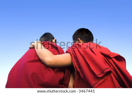 rear view of a monk holding another monk shoulder - stock photo