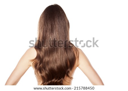 rear view of a naked woman with long hair