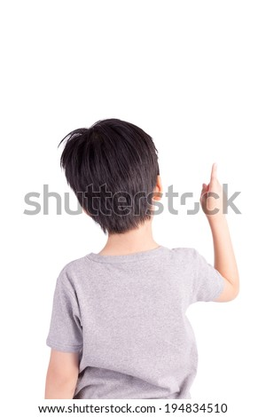 Rear view of a school boy over white background pointing upwards. Half length portrait - stock photo