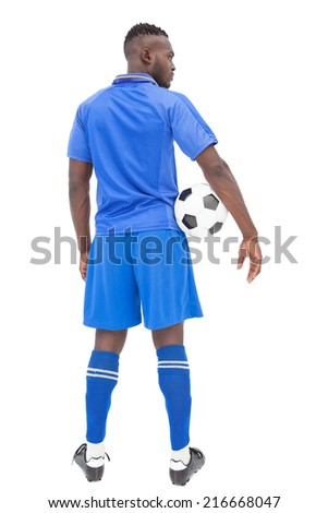 Rear view of a serious football player over white background