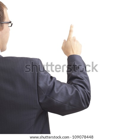 Rear view of a smart young male business entrepreneur pointing at copyspace over white background