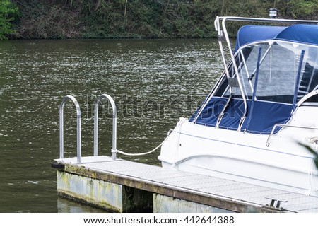 Rear view of a sports boat in the harbor. - stock photo