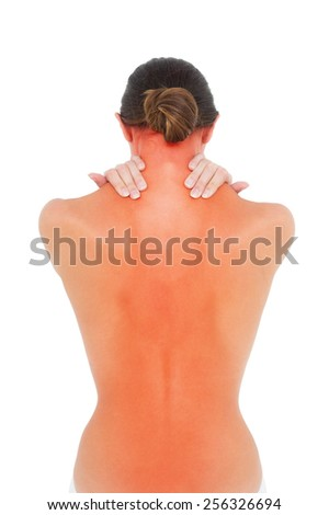 Rear view of a topless fit young woman with shoulder pain over white background - stock photo