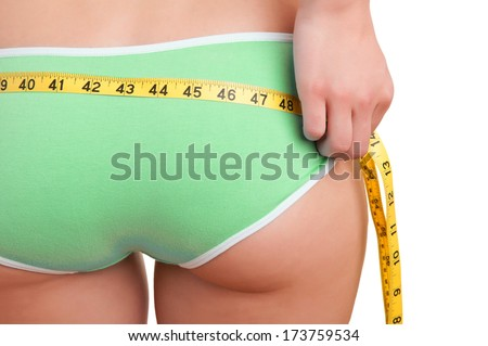 Rear view of a woman measuring her waist, isolated in white - stock photo