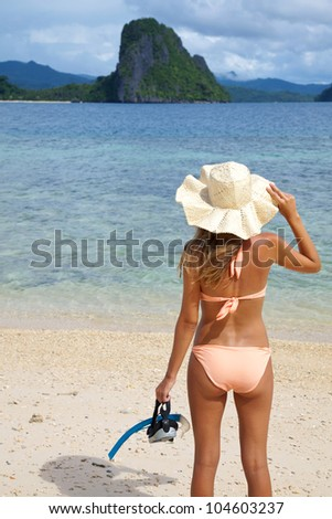 Rear view of a woman standing on a beach in El Nido, Palawan