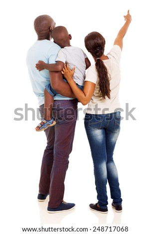 rear view of afro american young family pointing at empty space isolated on white background - stock photo