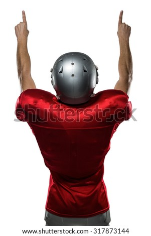 Rear view of American football player with arms raised standing against white background - stock photo