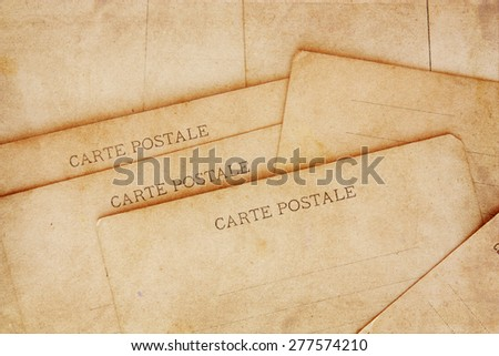 rear view of ancient post cards - stock photo