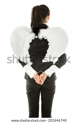 Rear view of angel side of a young Asian businesswoman with handcuffs isolated on white background - stock photo