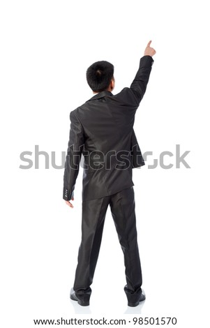Rear view of asian young business man  pointing at copy space isolated over white background, full length portrait of businessman standing back - stock photo
