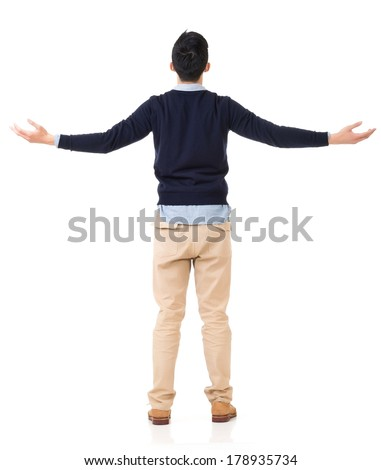 Rear view of Asian young man open arms and feel free, full length portrait. - stock photo