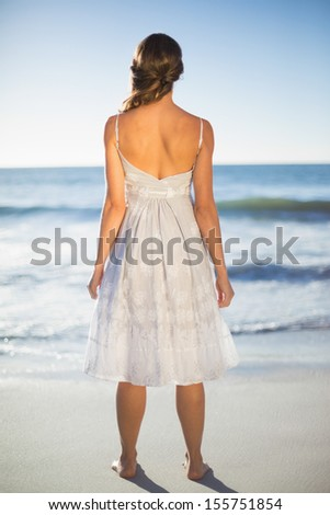 Rear view of attractive woman on beach on a sunny day