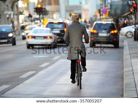 Rear view of bicyclist in full gear
