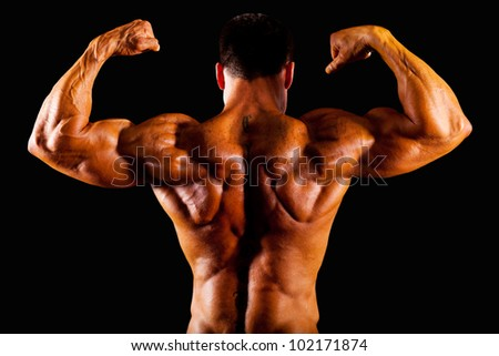 rear view of bodybuilder top - stock photo