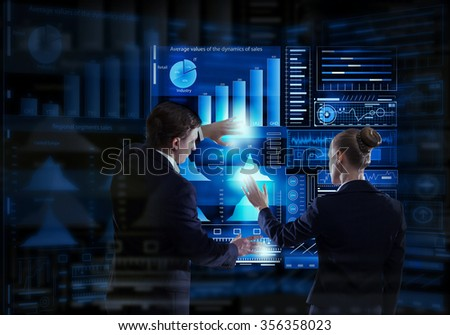 Rear view of businessman and businesswoman working with virtual panel interface